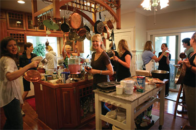 Kat in her kitchen at Mountain Chalet with the attendees at a Total Transformation Program.